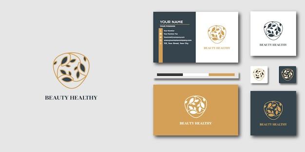 Logo et carte de visite de beauté d'art de ligne de luxe