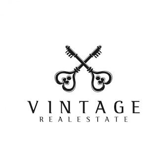 Logo clé croix pour l'immobilier