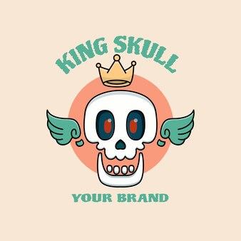 Logo crâne volant avec petites ailes et couronne