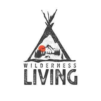 Logo dessiné à la main avec paysage de montagne et lettrage