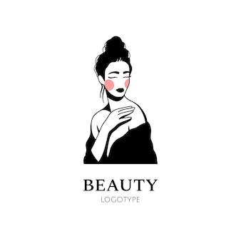 Logo de femme dessiné main beauté