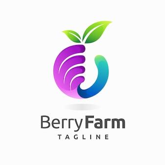 Logo de ferme de baies avec concept de main