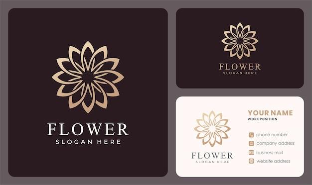 Logo de fleur élégant avec une couleur dorée.