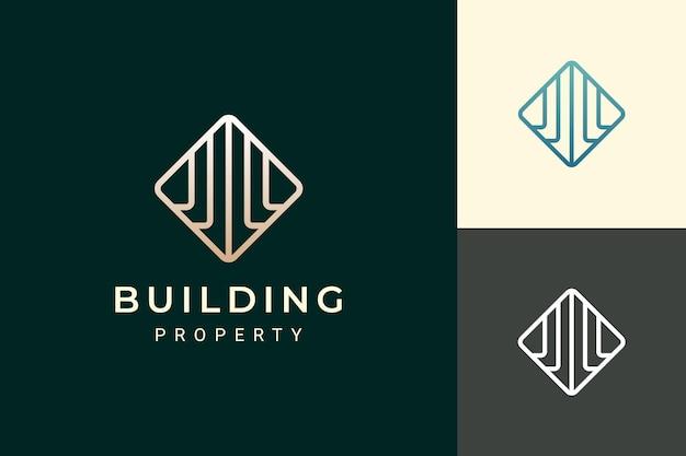 Logo de l'immobilier ou de l'appartement en forme de luxe et futuriste