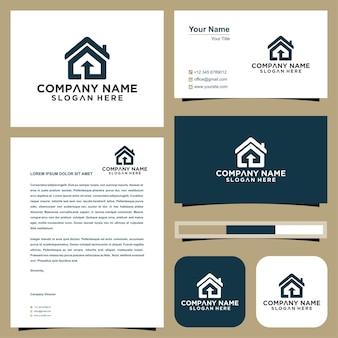 Logo immobilier avec flèche vers le haut vecteur premium et carte de visite