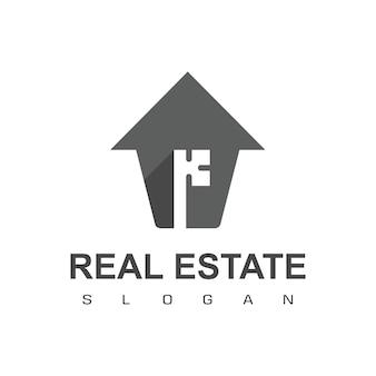 Logo de l'immobilier avec le symbole clé de la silhouette