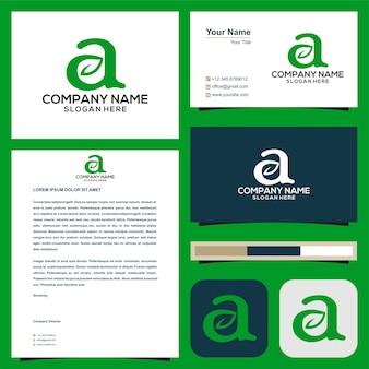 Logo initial une moissonneuse-batteuse avec feuille dans la carte de visite premium vector logo premium