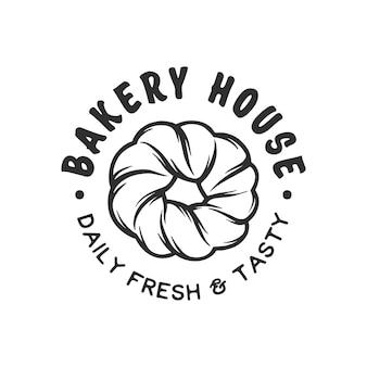Logo d'insigne d'étiquette de magasin de boulangerie de style vintage gravé