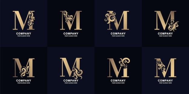 Logo de la lettre de collection m avec un design d'ornement de luxe