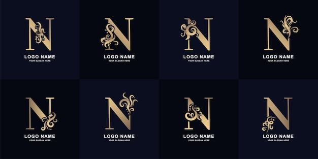 Logo de la lettre de collection n avec un design d'ornement de luxe