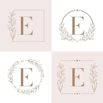 Logo de la lettre e avec modèle de fond de cadre floral