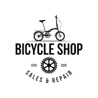 Logo de magasin de vélo