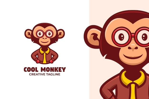 Logo de mascotte de dessin animé de singe souriant