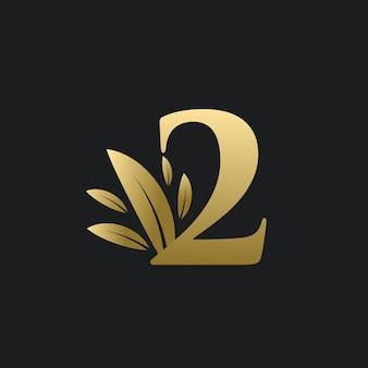 Logo numéro deux d'or avec des feuilles d'or. logo naturel numéro 2 avec feuille d'or.