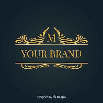 Logo ornemental doré pour la marque