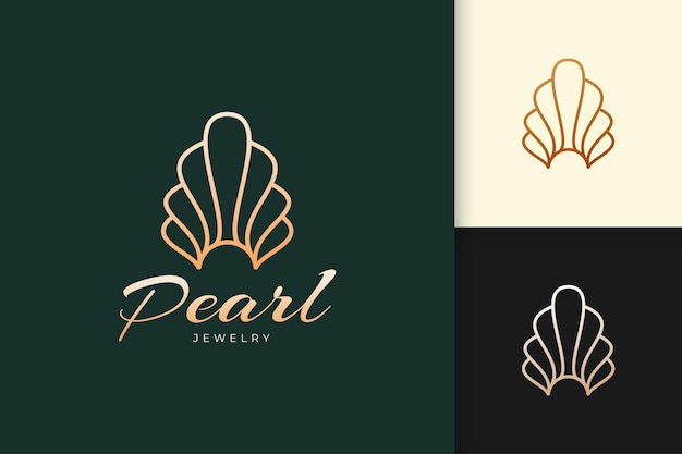 Logo de perle ou de bijoux dans le luxe et la classe en forme de coquillage ou de palourde