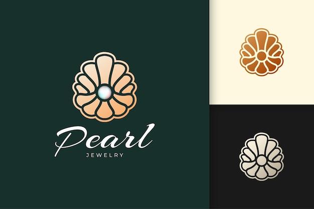 Le logo de perles de luxe et haut de gamme en forme de palourde abstraite représente des bijoux ou des pierres précieuses