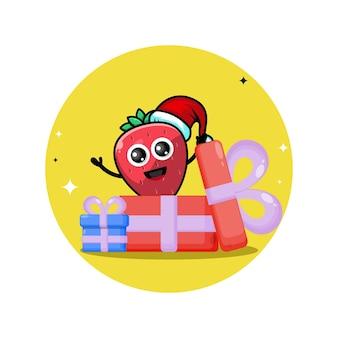 Logo de personnage mignon de cadeau de noël aux fraises