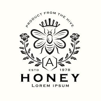 Logo reine des abeilles avec fleurs