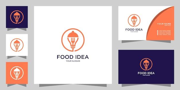 Logo de restaurant avec conception d'ampoule et de fourchette