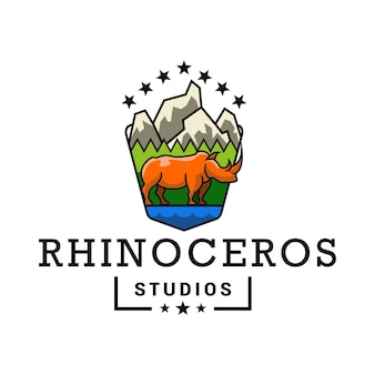 Logo rhinoceros mountain studio pour la photographie d'art et l'aventure nature