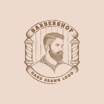 Logo de salon de coiffure dessiné à la main