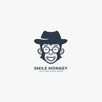 Logo de silhouette de sourire de singe.