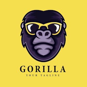 Logo tête de gorille cool à l'aide de lunettes