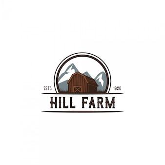 Logo vintage de fermier de colline