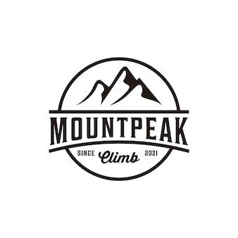 Logo vintage en plein air d'aventure sauvage au sommet de la montagne