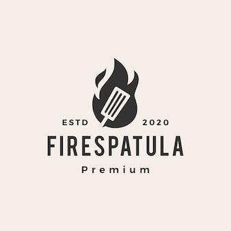 Logo vintage de spatule de feu