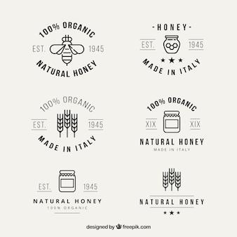 Logotypes de miel naturel mignon dans le style linéaire