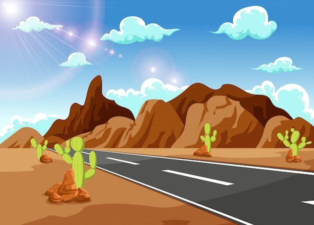 Longue route rectiligne menant aux montagnes lointaines