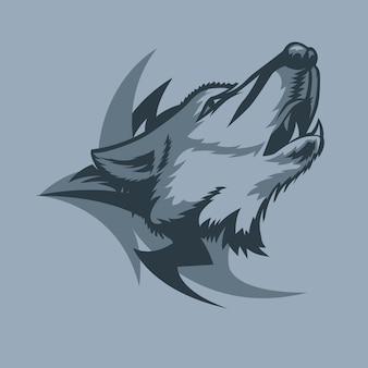 Loup hurlant solitaire et signe tribal derrière