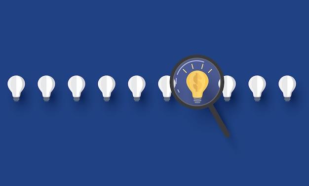 Loupe avec ampoule trouver la meilleure idée idée créative concept inspiration entreprise
