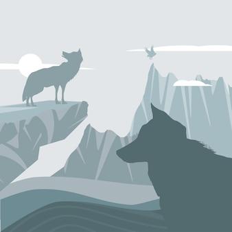 Loups de silhouette dans le paysage de montagnes