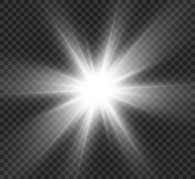 Une lumière brillante éclatante sur un fond transparent. particules de poussière magiques scintillantes. étoile brillante. soleil brillant transparent, flash lumineux. scintille. au centre se trouve un flash lumineux.