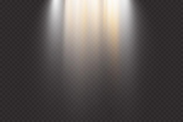 Lumière du soleil transparente. scène éclairée par les projecteurs. effet de lumière sur fond transparent.