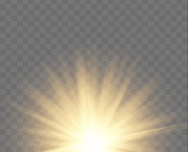 Une lumière rougeoyante jaune et or explose sur un fond transparent. des particules de poussière magiques étincelantes. étoile brillante. soleil brillant transparent, flash brillant. scintille. effet de lumière