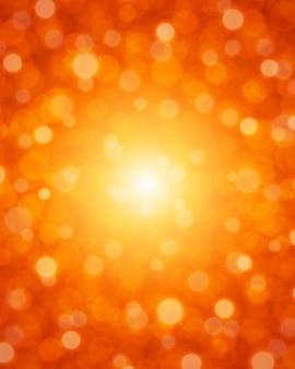 Lumière vive avec fond de particules rouges.