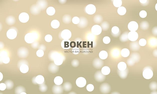 Lumières de bokeh blanc sur fond d'or jaune. lumières festives défocalisées.