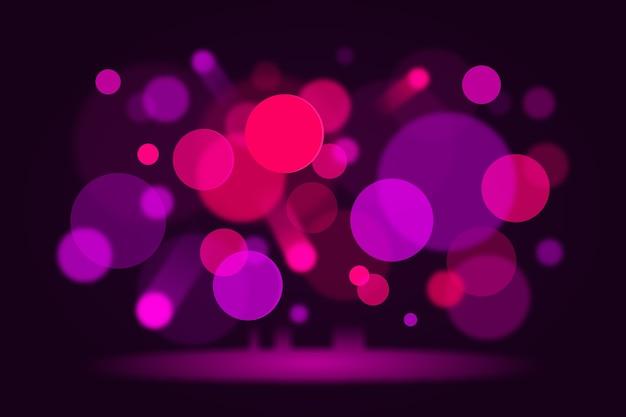 Lumières de bokeh rose sur fond sombre