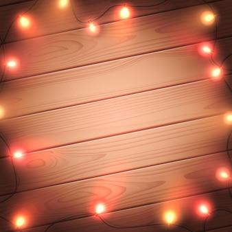 Lumières de noël isolés sur fond de bois. guirlande de noël lumineuse colorée. modèle vectoriel