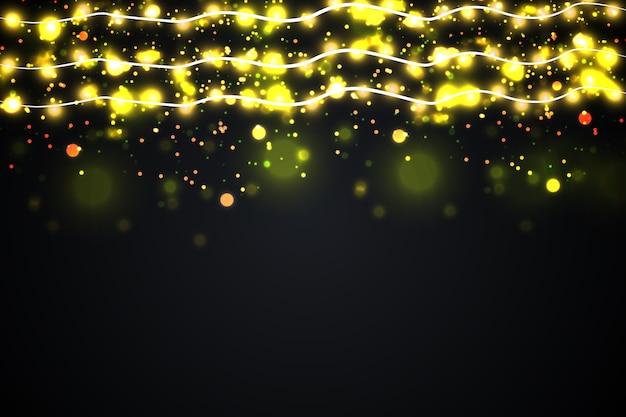 Lumières rougeoyantes pour la conception de cartes de voeux de vacances de noël. guirlandes, décorations de noël.