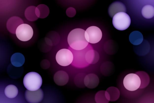Lumières violettes dégradées bokeh sur fond sombre