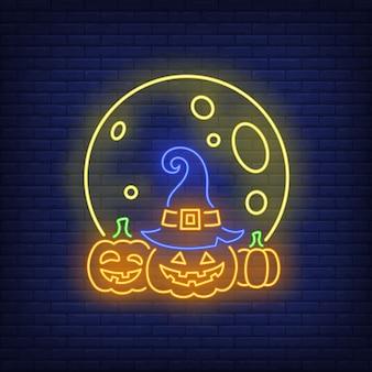 Lune et citrouilles enseigne au néon