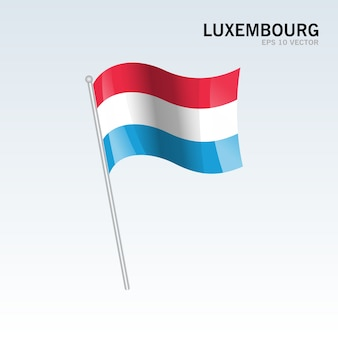 Luxembourg agitant le drapeau isolé sur fond gris