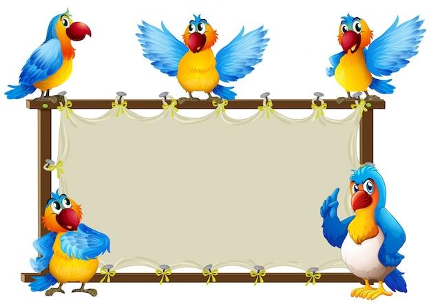 Macaw debout sur l'illustration du cadre en bois