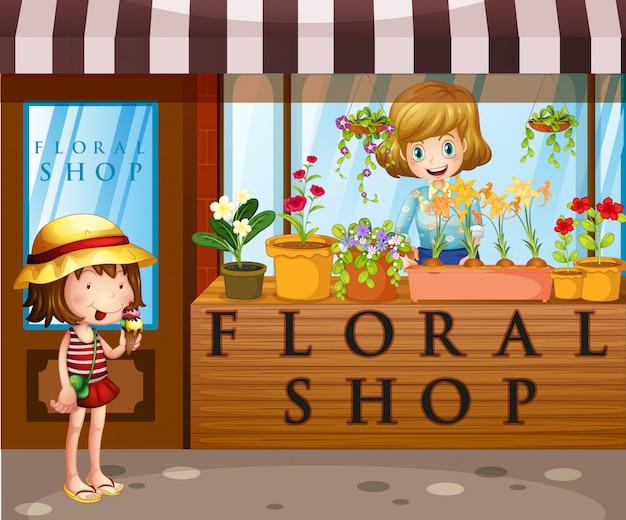 Magasin de fleurs avec le vendeur et le client