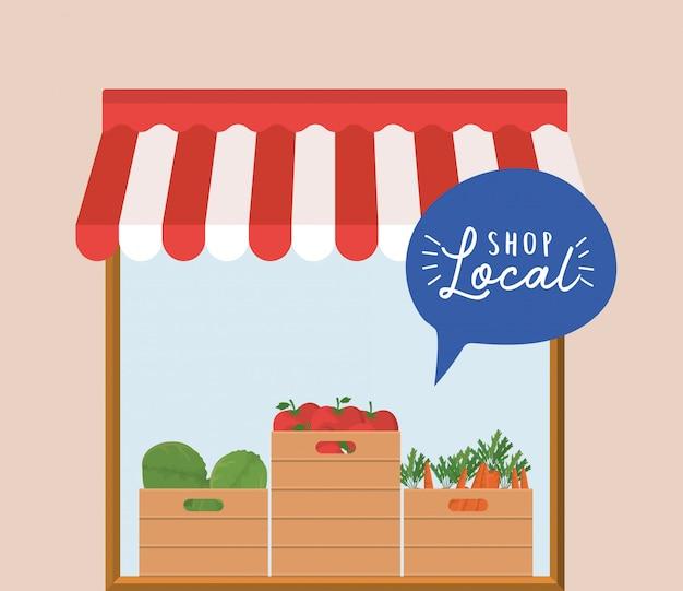 Magasin avec des légumes à l'intérieur des boîtes et boutique locale à l'intérieur de la bulle